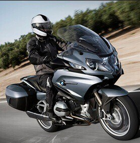 Black BMW motorcycle riding